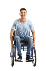 Handicapped young man in wheelchair on white background