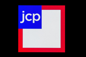 The logo for J. C. Penney Company, Inc. holding company is displayed on a screen on the floor at the NYSE in New York