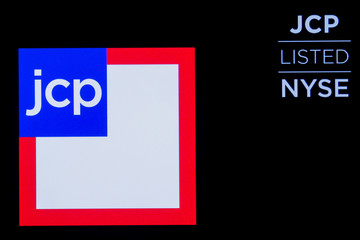 The logo and trading informations for J. C. Penney Company, Inc. holding company is displayed on a screen on the floor at  the NYSE in New York
