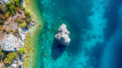 Ohrid Lake and Tarpeica little city in Macedonia with big rock in the lake  - drone photography