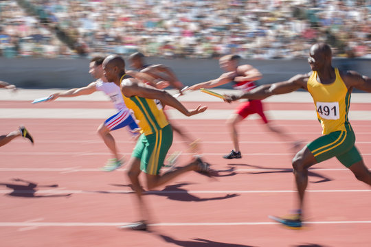 Blurred view of relay runners in race