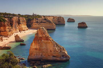 Marinha beach, with beautiful reefs and turquoise waters in the Algarve, Portugal.