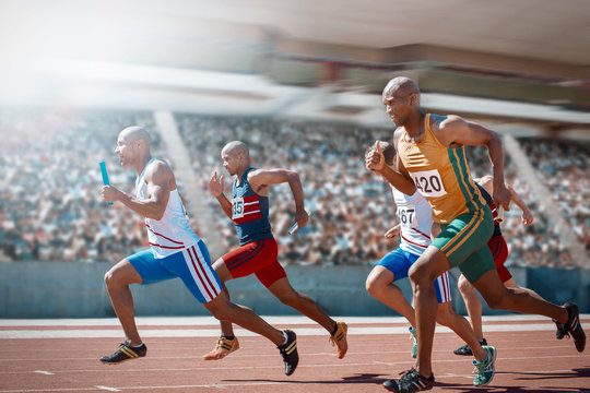 Relay runners racing on track