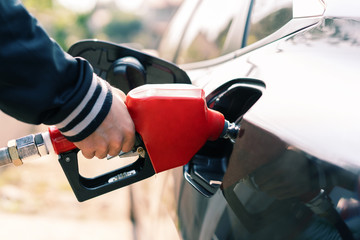 man's hand is refuelling gas or oil in the refuelling station prepare transport  to travel