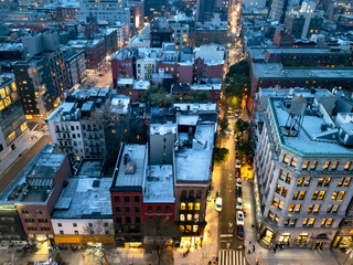 Overhead view of the busy streets of Nolita and SoHo neighborhoods with colorful night lights shining at dusk in Manhattan, New York City Fotomurales