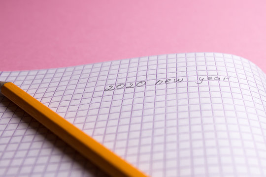 notebook with pen for 2020 new year