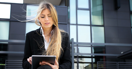 Smiling businesswoman using a digital tablet outdoor