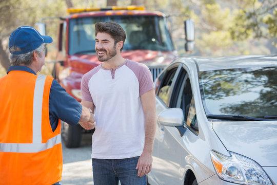 Man shaking hands with roadside mechanic