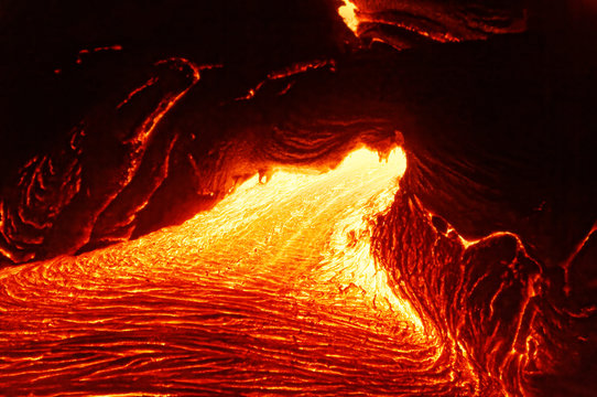 Detailed view of an active lava flow, hot magma emerges from a crack in the earth, the glowing lava appears in strong yellows and reds - Hawaii, Big Island, Kilauea volcano, Kalapana