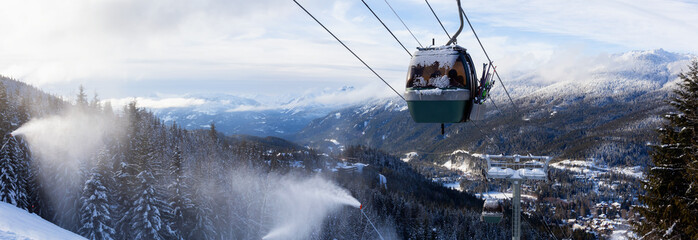 Fotobehang Gondolas Whistler, British Columbia, Canada. Panoramic View of Gondola going up the mountain during a vibrant and sunny winter day.
