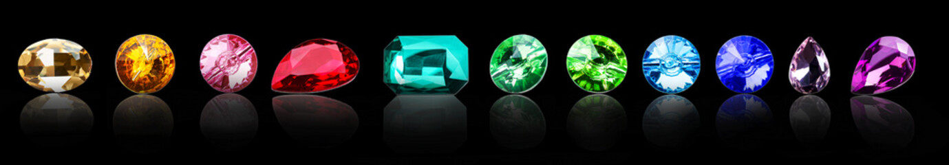 Different precious stones for jewellery on dark background