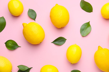 Ripe lemons on color background
