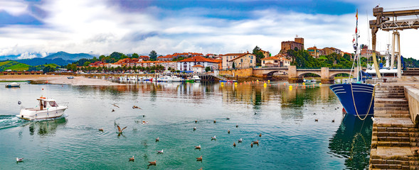 Fototapeten Dunkelgrau San Vicente de la barquera village in Cantabria,Spain.Scenic medieval village ,mountain and sea panoramic landscape in northern Spain.Green meadows and boats in the port