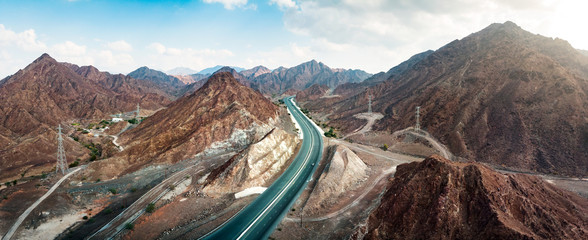 Scenic road through Hajar mountain range stretching through UAE and Oman