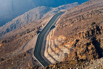 Desert mountain road on the Jais mountain in UAE aerial view