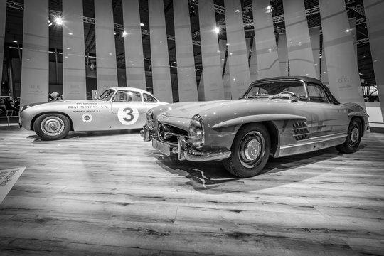 "STUTTGART, GERMANY - MARCH 17, 2016: Racing car Mercedes-Benz 300 SL (W194) and the sports car Mercedes-Benz 300 SL Roadster (W198). Europe's greatest classic car exhibition ""RETRO CLASSICS"""