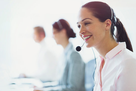 Smiling businesswoman talking on the phone with headset