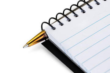 Spiral Notebook with Gold Ballpoint Pen over White