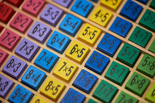 Multiplication table . Macro mode. Colored wooden cubes. Teaching children math and numeracy. Mental math.