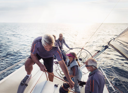 Retired friends sailing on sunny ocean