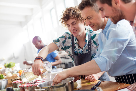 Male students in cooking class kitchen