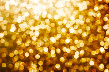 Golden shiny background. Abstract vibrant color glowing white spots texture for graphic design....