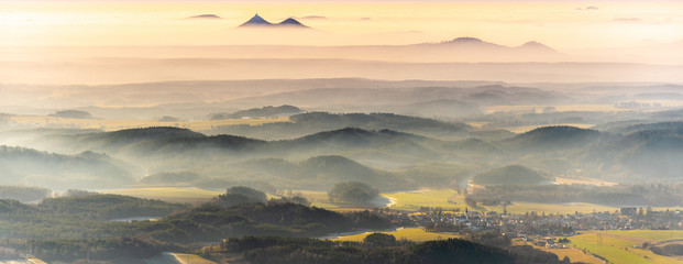 Foto auf Gartenposter Beige Bezdez twin mountains rising from the mist. Weather temperature inversion, Czech Republic