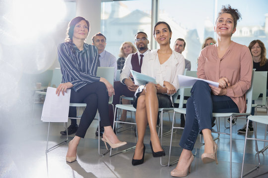Attentive businesswomen listening in conference audience