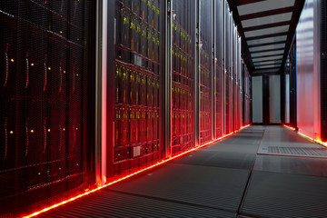 Red glowing panels in dark server room