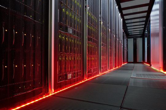 Red glowing panels in dark server room