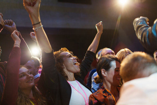 Enthusiastic woman cheering in audience