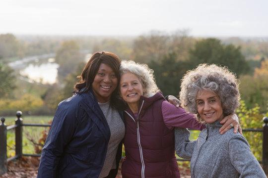 Portrait smiling, confident active senior women friends in autumn park