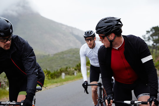 Male cyclist friends cycling