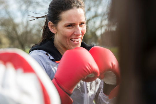 Determined woman boxing