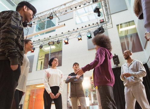 Teenagers talking in dance class studio