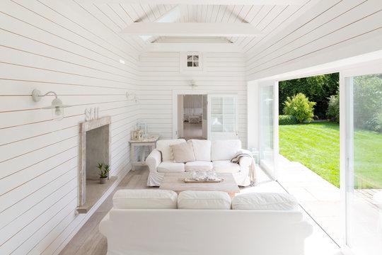 White wood shiplap a-frame home showcase sunroom