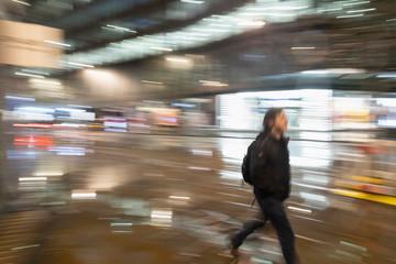 Man walking on urban street at night
