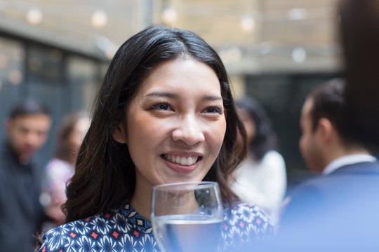 Smiling woman enjoying party