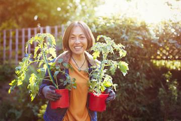 Portrait smiling, confident active senior woman gardening