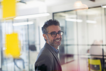 Portrait smiling, confident creative businessman in office