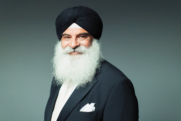 Portrait smiling, confident well-dressed senior man wearing turban