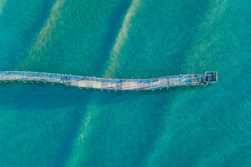 Aerial view of wood fishing pier Wall mural