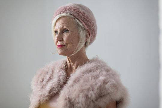 Portrait elegant senior woman wearing fur