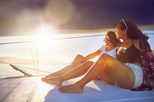 Young women relaxing on sunny boat