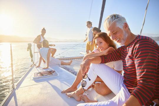 Friends relaxing on sunny catamaran