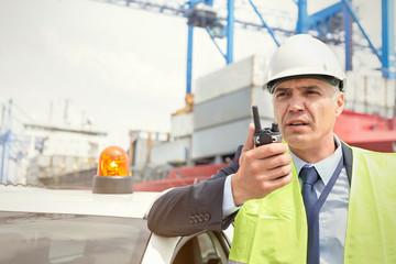 Dock manger with walkie-talkie at shipyard