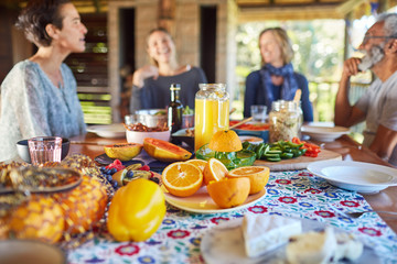 Friends enjoying healthy breakfast at table during yoga retreat