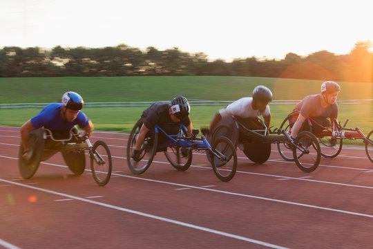 Paraplegic athletes speeding along sports track in wheelchair race