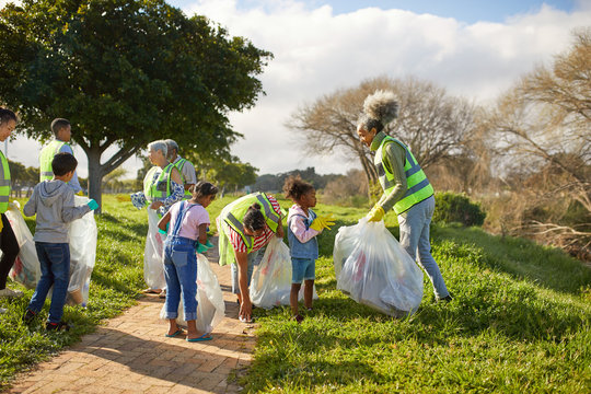 Volunteers cleaning up litter in sunny park
