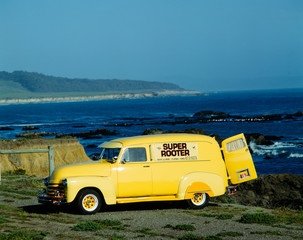Bright yellow truck along Pacific Coast Highway, California